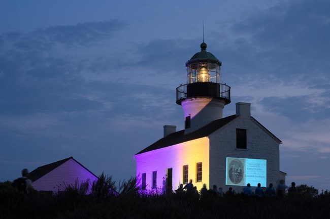 Bill Griswold Forward Into Light Lighthouse With Projection
